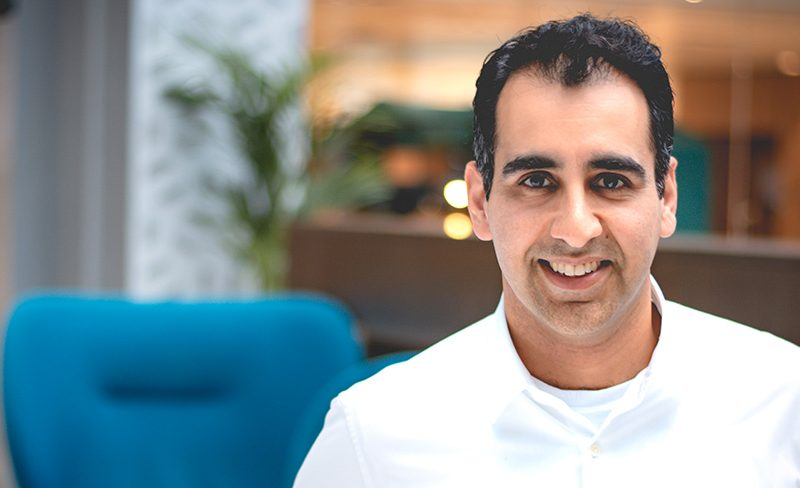 A profile headshot of Ammad Ahmad, Atheneum founder and managing director.