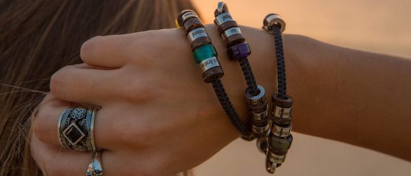 El Camino bracelets against a sunset in a beautiful travel destination.