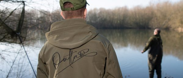 A fisherman standing by Outlaw Pro's lake in Essex near their new megastore.